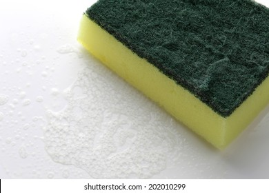 scrubber pad with sponge and bubble of washing liquid