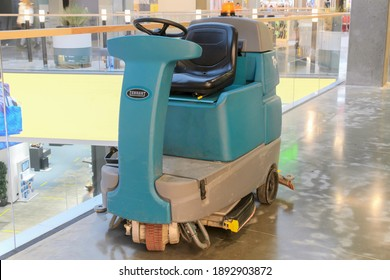 Scrubber Tennant with driver's seat and steering is designed for cleaning floor surfaces and picking up light debris. Used in malls, shopping centers, public places. Moscow Russia 01.10.2021
