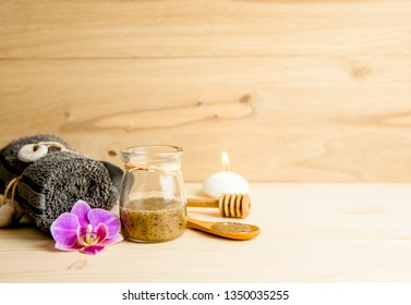 Scrubbing honey and coffee mixture on body in hot sauna helps open the pores and renew, rejuvenate the skin on body. Sauna treatment concept. Lot of copy space.
