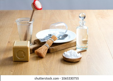 scrubbing, rubbing and cleaning dishes with homemade eco friendly washing detergent, green still-life