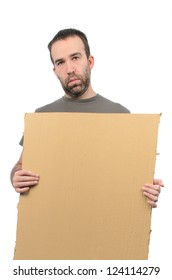 A scruffy looking guy holding a cardboard sign, isolated on a white background.