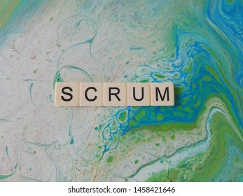 Scrum word on abstract background
