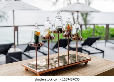 Scrumptious tapas with an Asian twist on vintage copper chandelier stand at the pool bar. Attractive Hotel's guest amenity setup and decoration.