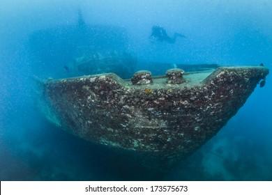 Scuba Diver alone at the Atlantic Princes Shipwreck in Bayahibe, Dominican Republic in Caribbean Sea
