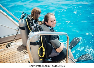 Scuba diver before diving. Diving lesson in open water.