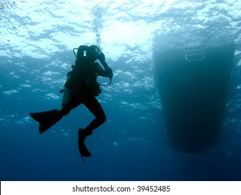 Scuba Diver Clearing Mask while Descending under the Boat