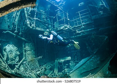 Scuba diver exploring the interior of a shipwreck called Chrisoula K in Abu Nuhas, Red Sea.