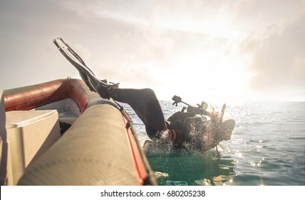 Scuba diver jumping down in the water