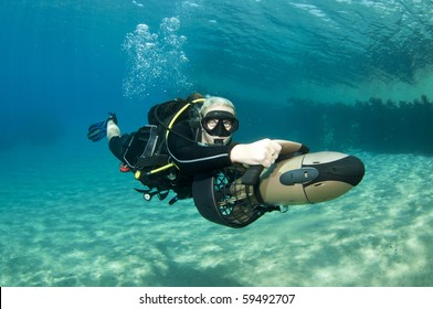 scuba diver on underwater scooter