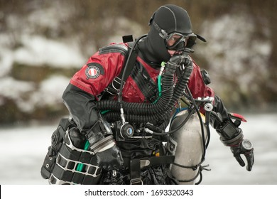 Scuba diver with rebreather after the dive in frozen quarry in the middle of Europe