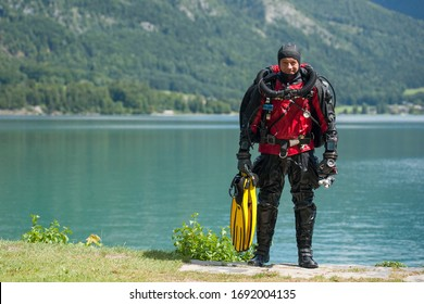 Scuba diver with rebreather and dry suit just after the dive in deep lake