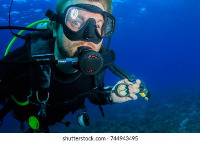 A SCUBA diver running very low on air underwater