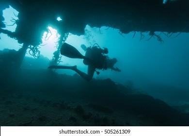 Scuba diver in a ship's wreck.