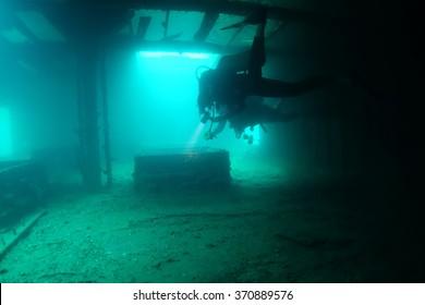 Scuba diver in a shipwreck