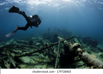 Scuba diver swimming over a Ship wreck