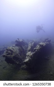scuba diver taking photo old wooden ship wreck underwater 1800s