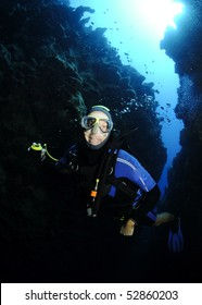 scuba diver in underwater canyon