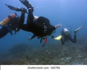 Scuba divers at 15 metres depth off Perhentian Island, Malaysia