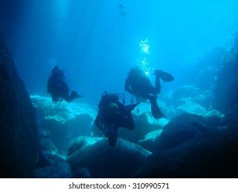 Scuba divers inside a cave