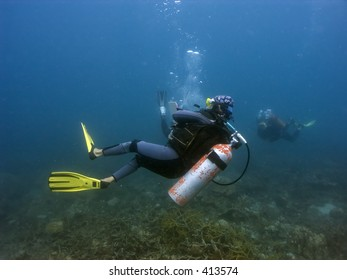 Scuba divers in Malaysian waters off Perhentian Island