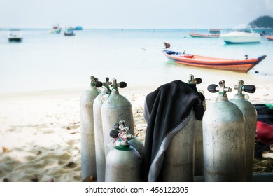 Scuba diving air tanks on the beach.