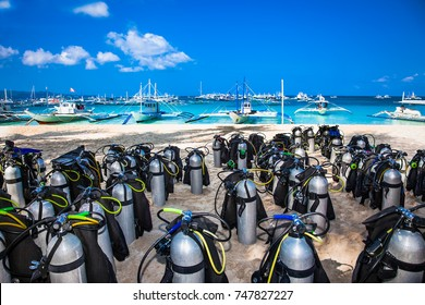 Scuba diving air tanks at White beach, Boracay island, Philippines. Diving scuba center with tanks ready for beginner or advanced diving courses.