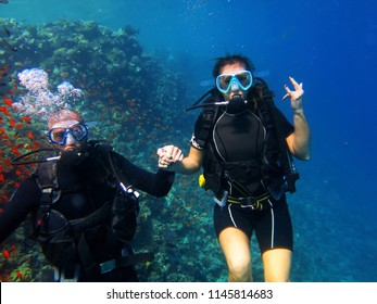 Scuba diving. A couple of divers posing underwater. Red Sea , Egypt