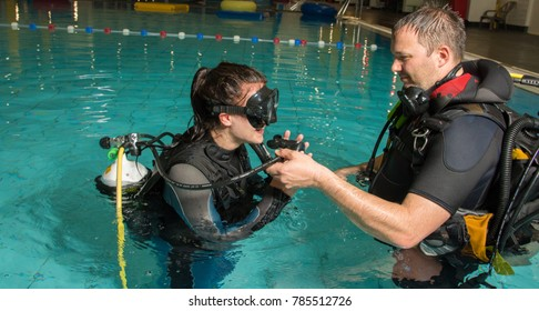 scuba diving course pool teenager girl with instructor in water