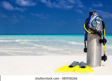 Scuba diving equipment on a tropical beach