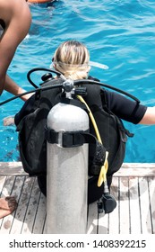 Scuba diving instructor deck of the sailboat. Divers Young woman lesson with trainee lesson in open water.