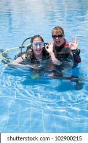 Scuba diving instructor and student having fun  in a swimming pool