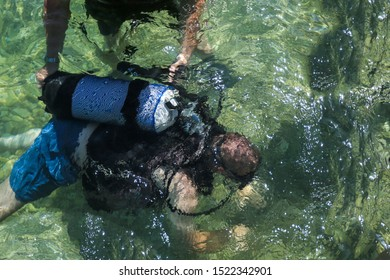 Scuba diving instructor and student swimming in sea