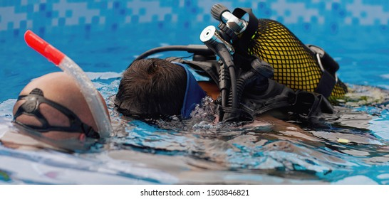 Scuba diving lesson with children trainee and instructor