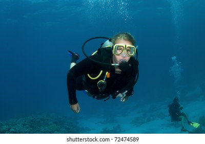 Scuba diving in the ocean with clear blue water