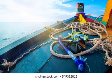Scuba diving and snorkeling. Two snorkel on blue wooden deck of a ship. Wooden background. Excursions to the islands of Thailand