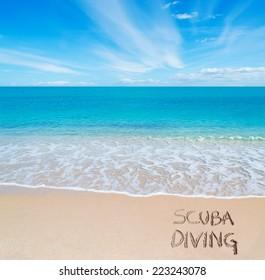 """""""scuba diving"""" written on a tropical beach"""