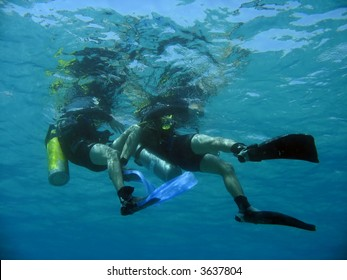 a scubadiver pulls his buddy during a drill