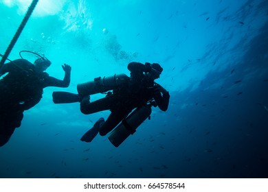 Scubadiver in a sidemount configuration of equipment