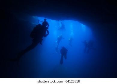 Scuba-divers in a cave