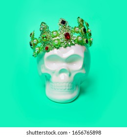 Scull in crown on a mint background. Minimal concept art.