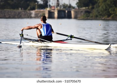 Scull rowing team training. Athletic water sport.