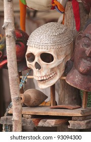 Scull for sale in a market stand among other stuff.