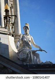 Sculptors on lady on building