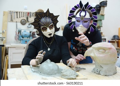 sculptors in theatrical masks