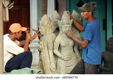 Sculptors in Trowulan tourist village (the largest royal heritage in Indonesia, Majapahit), are completing the stone carvings before being sent to Bali on April 18, 2005