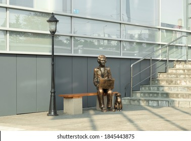 """The sculptural composition """"Boy with a laptop and a cat"""" in the city of Kaliningrad. Russia. Russia october 2020"""