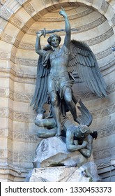 Sculpture in an alcove at the Basilica Sacre Coeur, Montmartre, Paris of the Archangel Michael defeating Lucifer