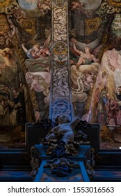 Sculpture of an angel with fresco mural paintings of the church of San Nicolás in Valencia, Spain