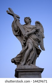 Sculpture of an angel with wings on a background of blue sky