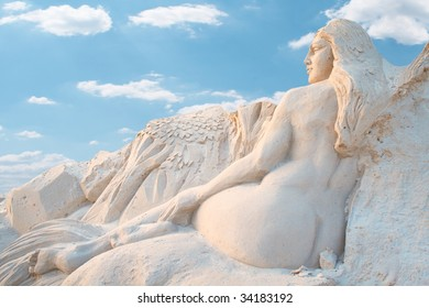 Sculpture of the bared girl. Is made of sand